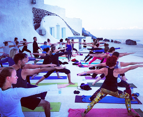 This is what yoga in Santorini looks like, folks