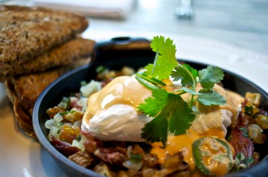 Duck and Green Chile Hash with Poached Eggs and Chipotle Hollandaise