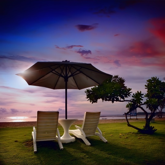 Beach chairs on perfect tropical white sand beach Bali.jpg